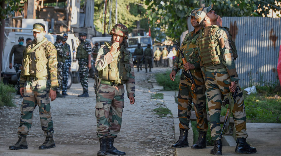 Security forces during an encounter with militants at Kawoosa area of the Central Kashmir on Monday.