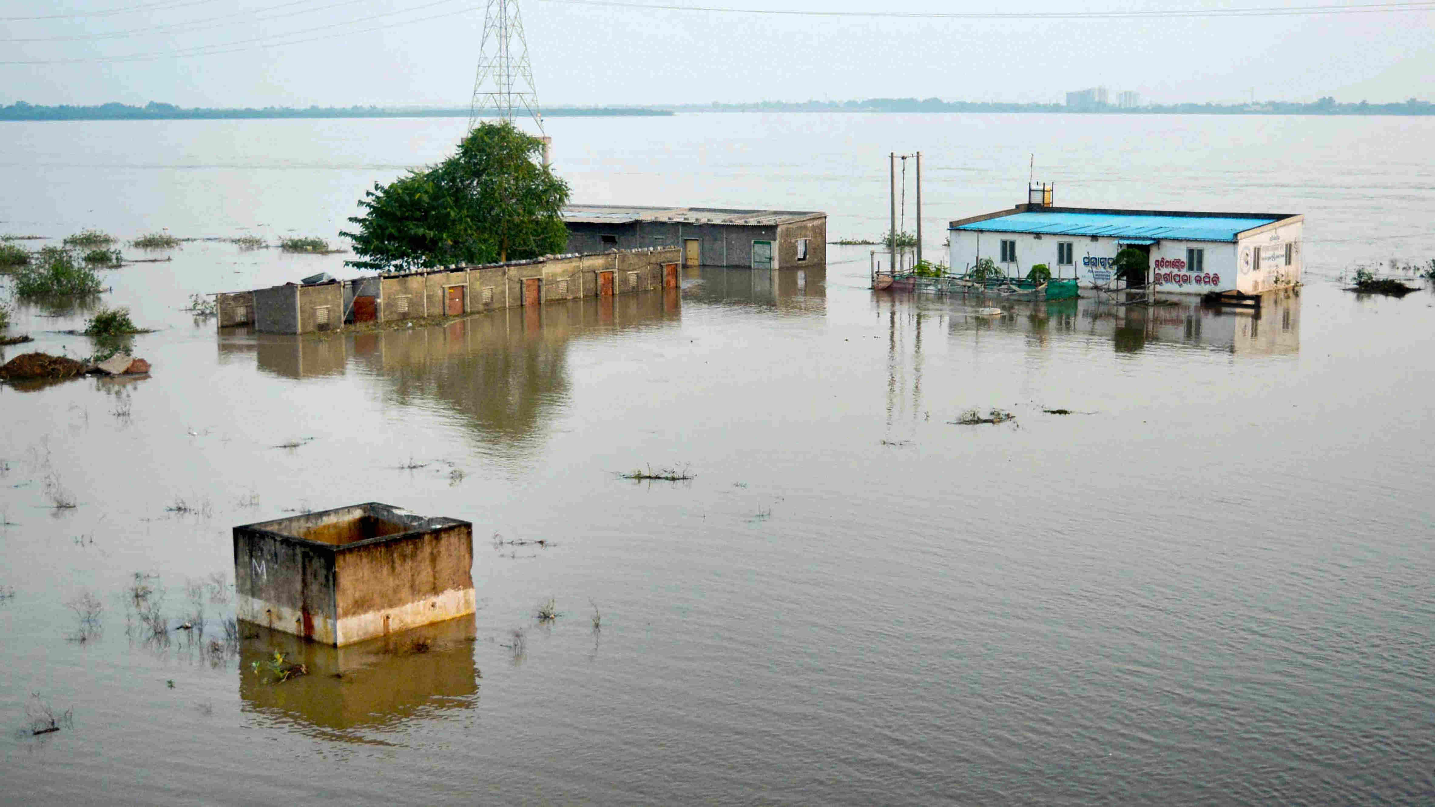 A low-lying locality submerged in flood waters following heavy rainfall in Cuttack district on Aug. 30, 2020.