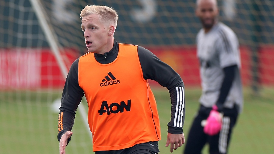 Donny Van De Beek goes for a ball during a training session with Manchester United