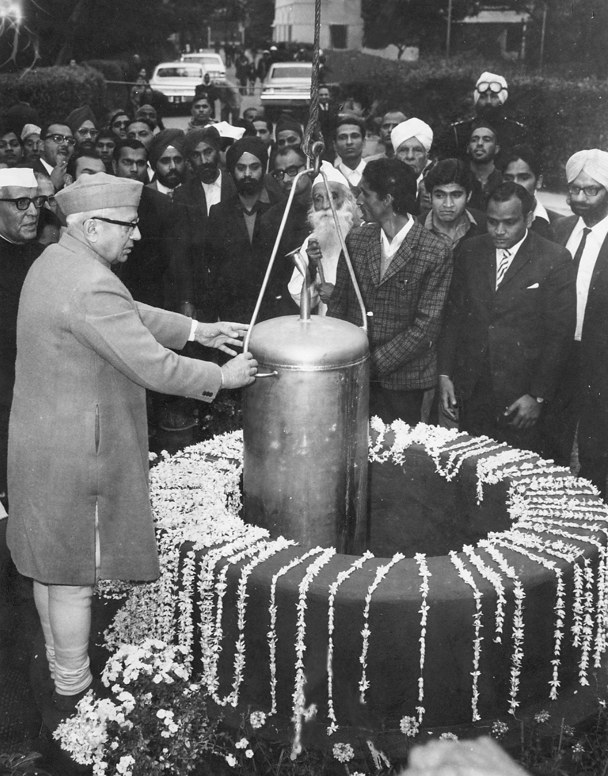 A time capsule devoted to the life and works of Mahatma Gandhi being embedded by Vice President G. S. Pathak in New Delhi.