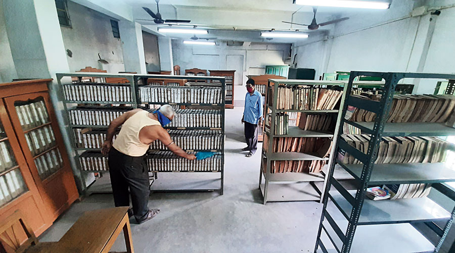 Employees of the 164-year-old Krishnagar Public Library clean and dust an archive of old books and other sections on Saturday.