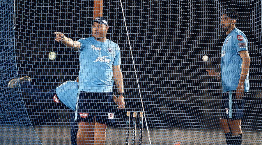 Ryan Harris at nets with Ishant Sharma.