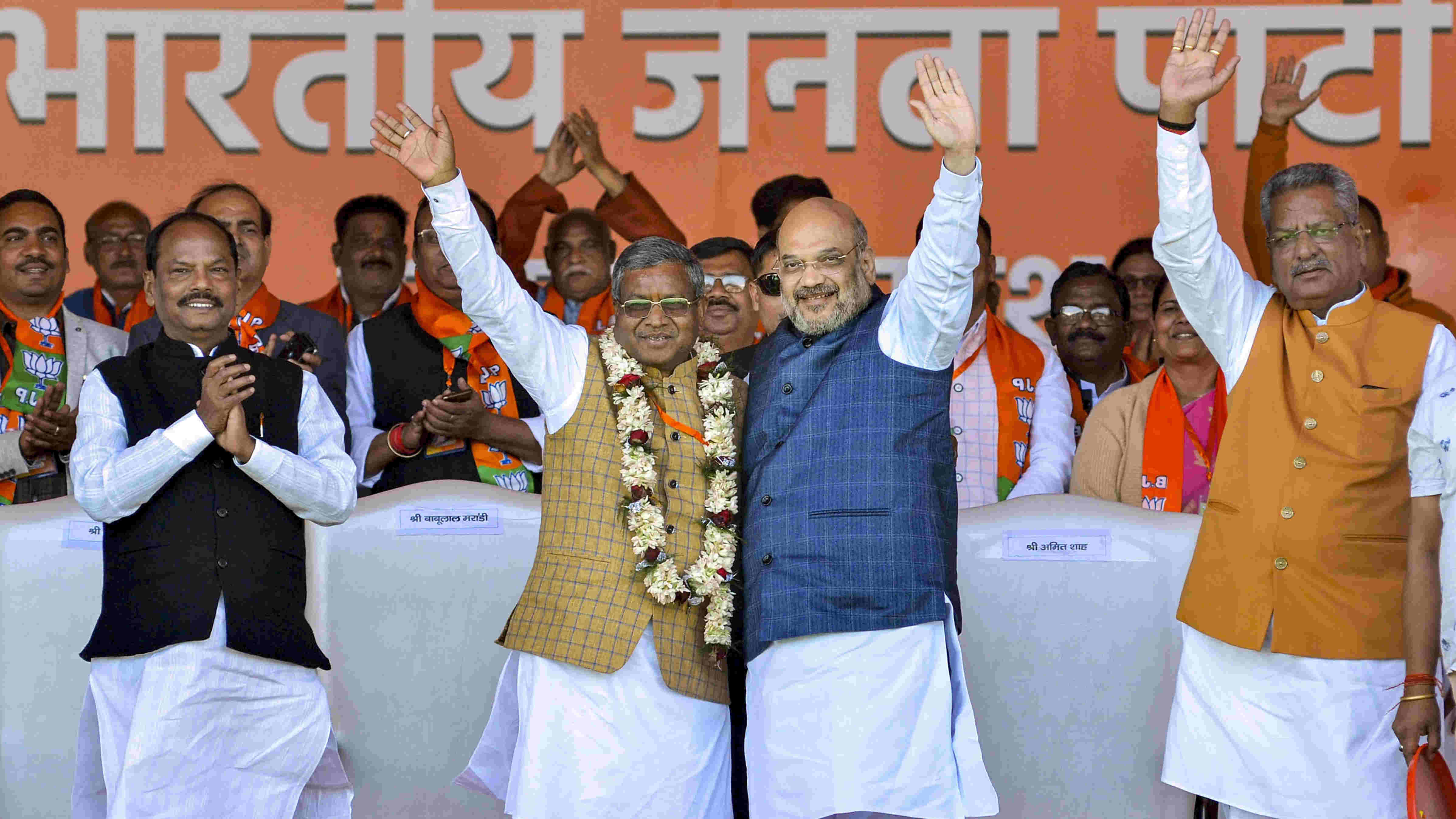 Babulal Marandi with senior BJP leader and Union home minister Amit Shah when he merged his JVM (P) with the BJP in February this year. On his right is former chief minister Raghubar Das.