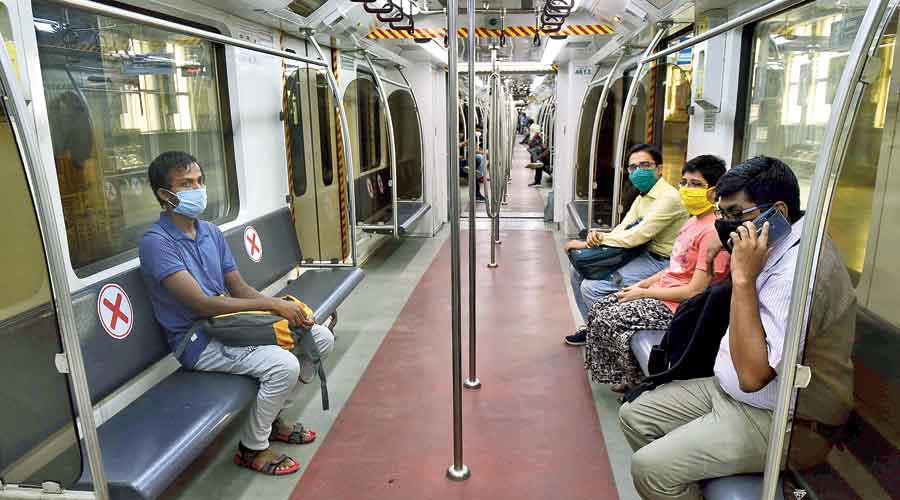 NEET aspirants and family members on board a Metro train that ran in Calcutta on Sunday after 173 days. From Monday, Metro will run 110 trains every day for regular passengers. The first and last trains will leave the terminal stations at 8am and 7pm, respectively. Passengers will have to book an e-pass to enter stations and use a smart card to enter  the platform. The services will be suspended every Sunday.