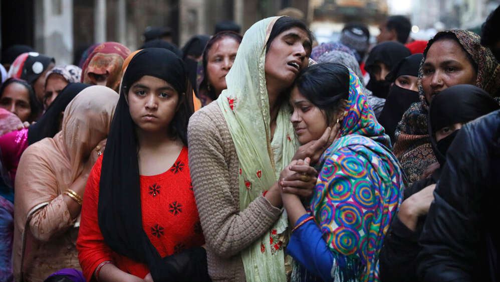 Relatives and neighbours of Mohammad Mudasir who was killed in the violence in New Delhi.