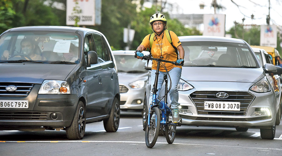Lipika Biswas cycles on a road in Kasba.