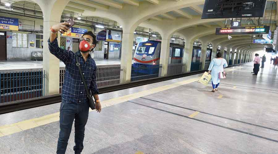 Panchanan Srivastav, a college student, takes a selfie at Tollygunge Metro station on Monday morning