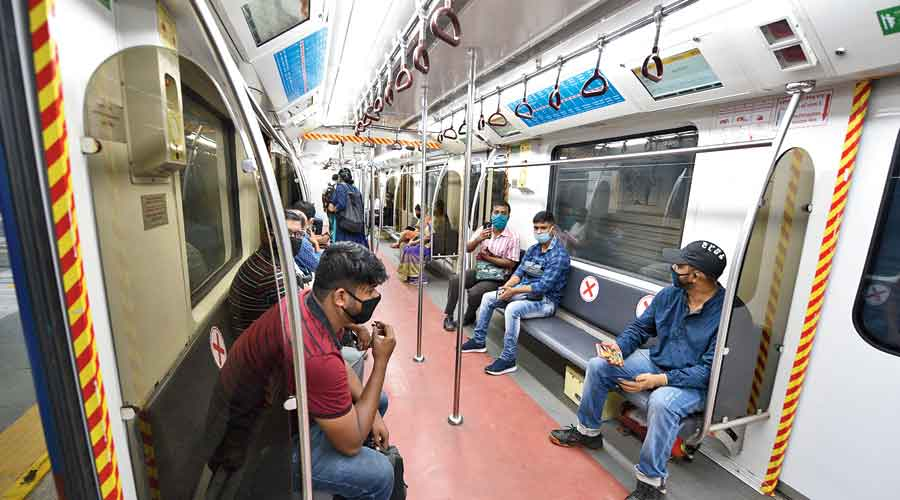 9.50AM: Passengers on a relatively empty Metro train  at Kalighat station on Monday