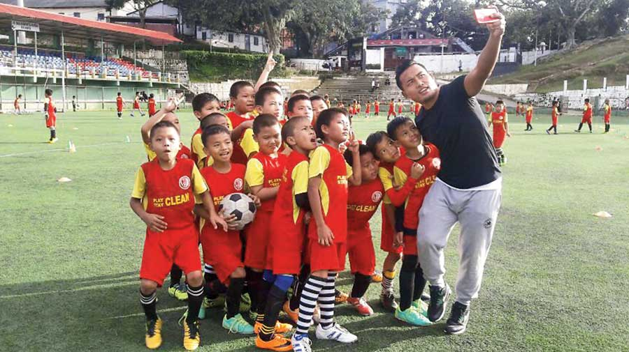 Jeje with the children as part of the MFA  Grassroots project.