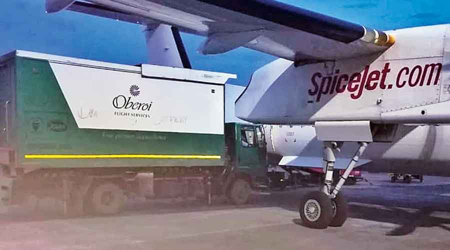 A truck carries food packets to an aircraft