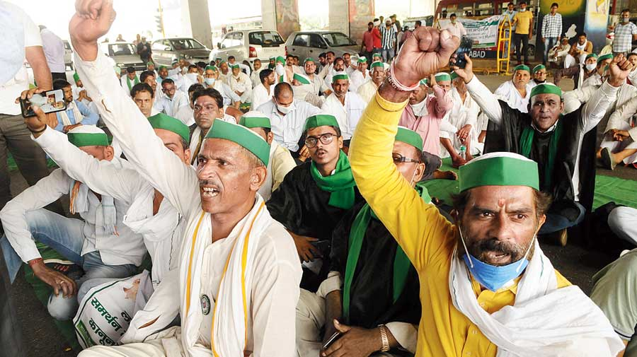 Bharatiya Kisan Union leaders and farmers stage a protest at Delhi-Uttar Pradesh border against the Centre's policies on Monday.