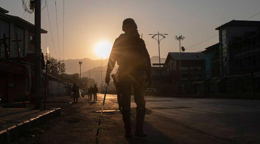 Soldiers patrol a deserted street in Srinagar.