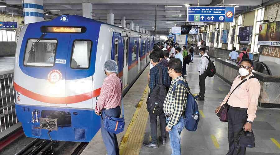 A train rolls into the platform at  Dum Dum Metro station
