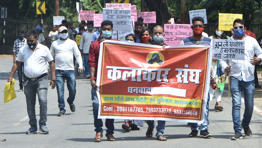 Performing artistes, under the banner of Kalakar Sangh, Dhanbad, on a silent march with placards in Dhanbad on Tuesday.