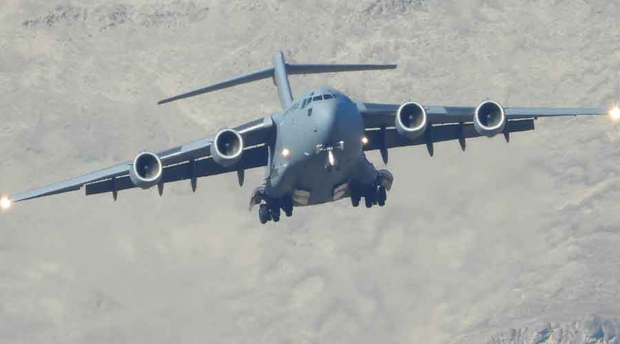 C-17 Globemaster of the Indian Air Force flies over Ladakh region in Leh district on Tuesday