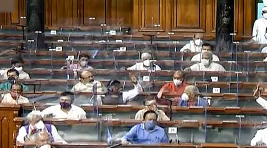 Parliamentarians in the Lok Sabha attend the ongoing Monsoon Session of Parliament in New Delhi on Tuesday