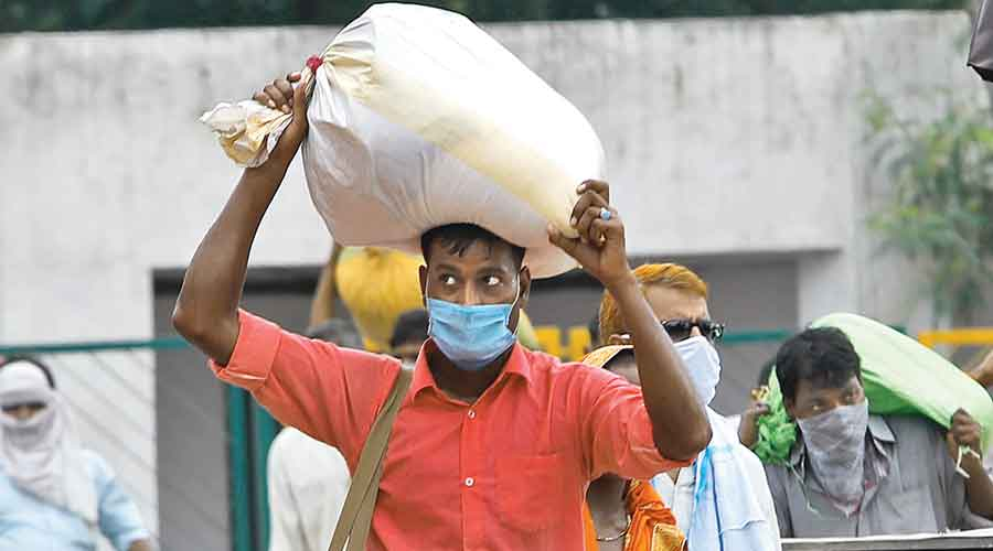 A migrant labourer returns to New Delhi for work on August 18