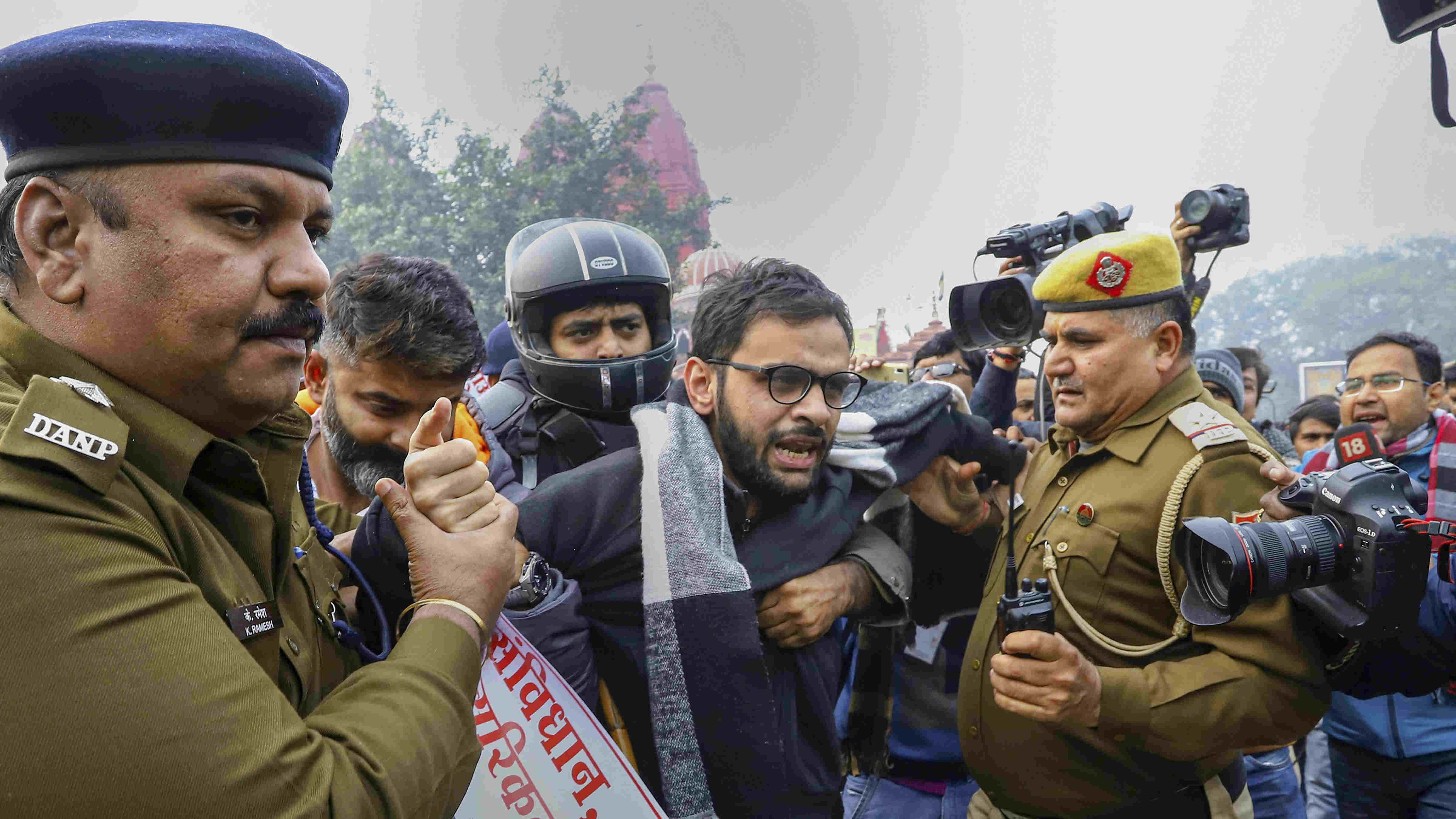In this file photo dated Dec. 19, 2019, former JNU student and activist Umar Khalid is detained by police for defying prohibitory orders imposed by the Delhi Police in the area during an anti-Citizenship Act protest, at Red Fort, in New Delhi.