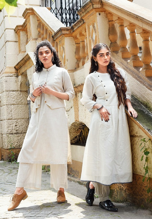 "3. This all-white look has an element of pristine cool. The old building near Telephone Bhavan adds an old-world warmth. Subhamita is in a khadi kurta, striped pants and waistcoat, paired with brogues. ""Androgynous and understated,"" describes Sayantan. Olivia has kept it minimal with silver earrings with a hint of gold, silver bracelet which is more like an anklet, and nude lips. Bibriti's white-on-white polka jamdani kurta, which can be worn as a dress too, has an asymmetric neckline and her striped pants are gathered at the ankle. Brogues, silver chaandbalis and bangles complete the look."