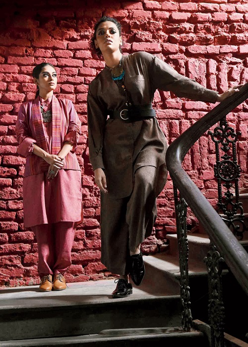 4. Subdued drama and androgyny is the mood here. While Subhamita is dressed in an oversized shirt and flared straight pants with an asymmetrical hemline, Bibriti has slipped on a short jacket on a man's kurta with salwar pants. Chunky neckpieces and smokey eyes add the feminine touch.