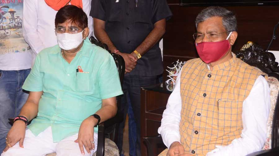 BJP leader Babulal Marandi (right) with Dhanbad MLA Raj Sinha in Dhanbad on Wednesday evening.