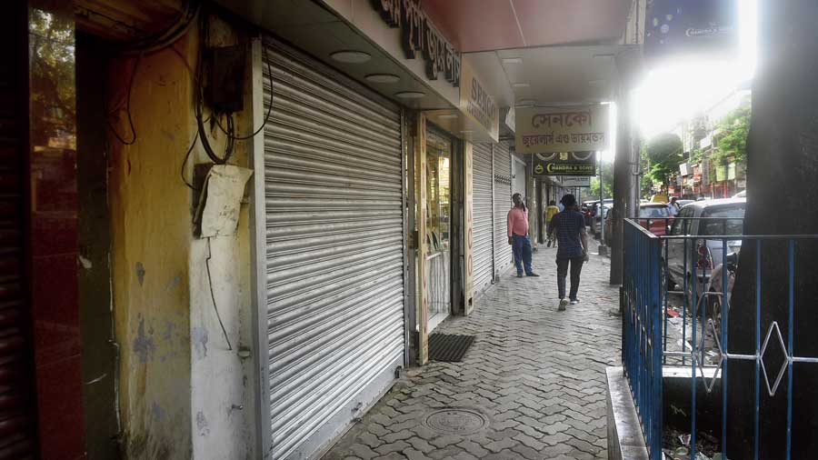 A lone jewellery store stands out in a row of similar stores that kept their shutters down in the Bowbazar area on Thursday.
