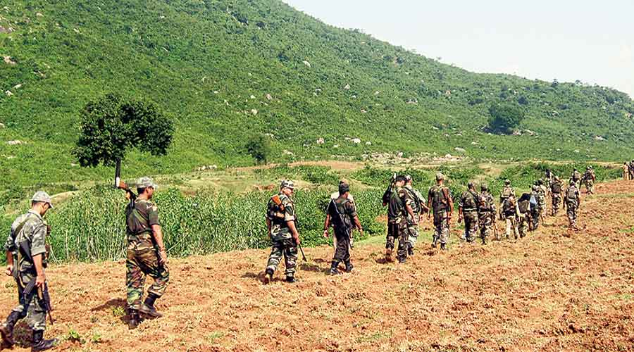 Paramilitary personnel patrol the Ayodhya hills.