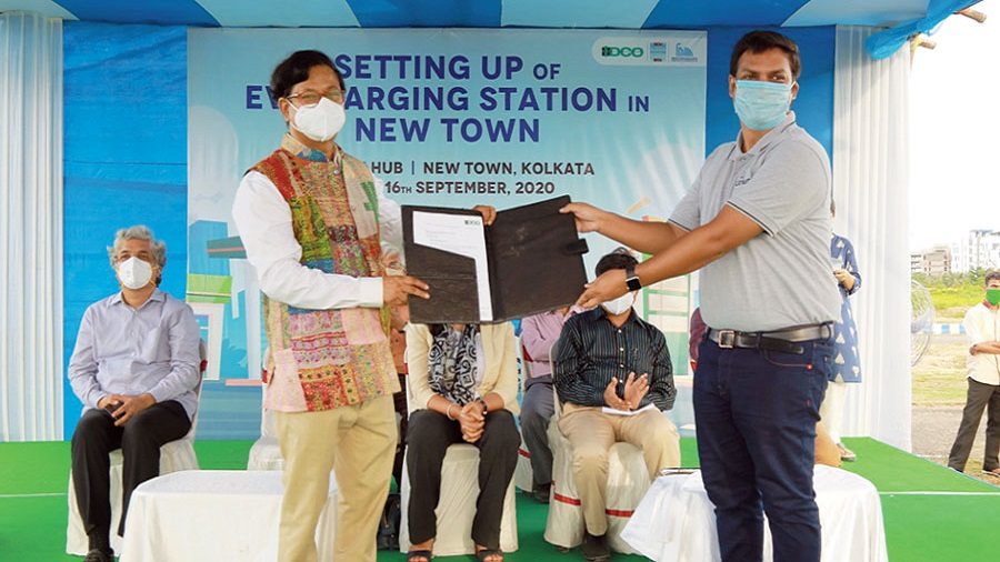 Debashis Sen hands over a letter of intent on Wednesday to a representative of Shuchi which will run the e-charging station located next to the proposed multi-level car parking complex near the Biswa Bangla Convention Centre