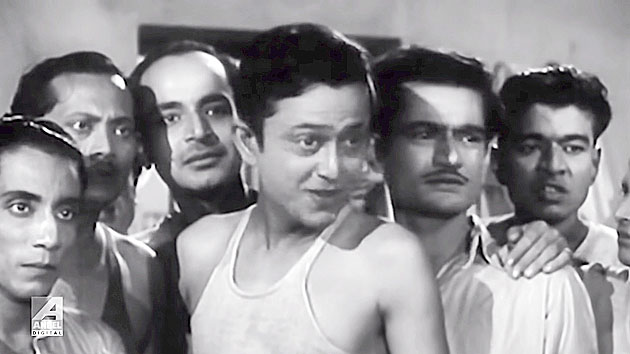 5. The film that introduced Bhanu Bandyopadhyay as an unique talent was Basu Paribar. But this is a still from the movie which launched him as a lead actor. In this scene he is seen with a bunch of very talented co-stars. Identify the one to his exact left and one to his extreme right.