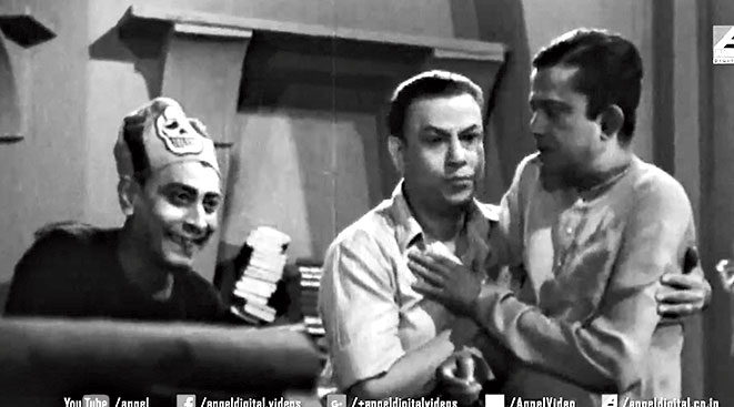 12. Bhanu Bandyopadhyay's comedy act was often supported by some brilliant actors, most famous among them being Jahar Roy. However, in this scene we can see two other actors who also belonged to the gang of laugh rioters. Identify them.