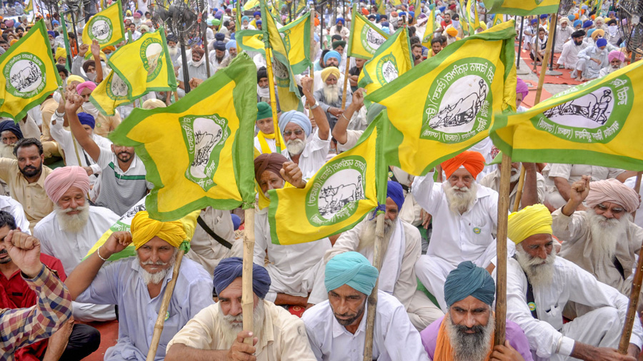 Members of various farmers organisations hold a protest over agriculture related ordinances, in Patiala, Friday, Sept. 18, 2020.