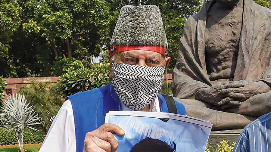 National Conference chief Farooq Abdullah during a protest near the Mahatma Gandhi statue in Parliament on Saturday.