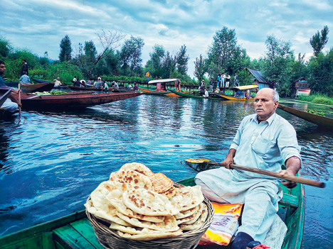 The early morning floating market of #Srinagar; where you'll find fresh veggies cultivated right there in the wetlands, and other wares like Kashmiri breads too! Not just a spot for business, but also a leisurely chat, argument or a #hookah break while they wait in their #shikara for customers.