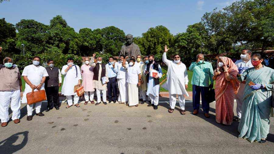 Rajya Sabha MPs stage a protest after the two farm bills were passed in the House on Sunday.