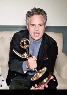 Mark Ruffalo with his Emmy at home