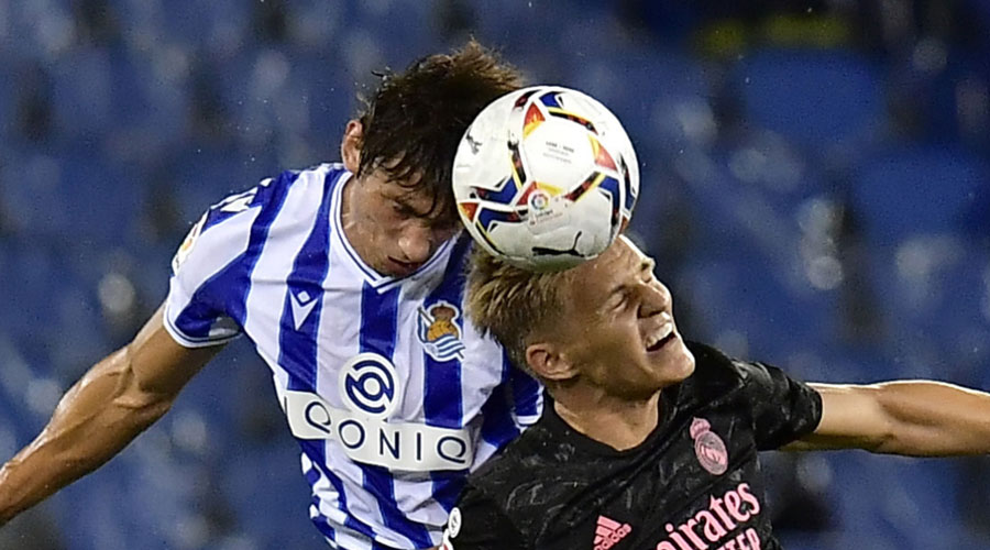 Real Madrid's Martin Odegaard (right) and Robin Le Normand of Real Sociedad in an aerial tussle on Sunday.