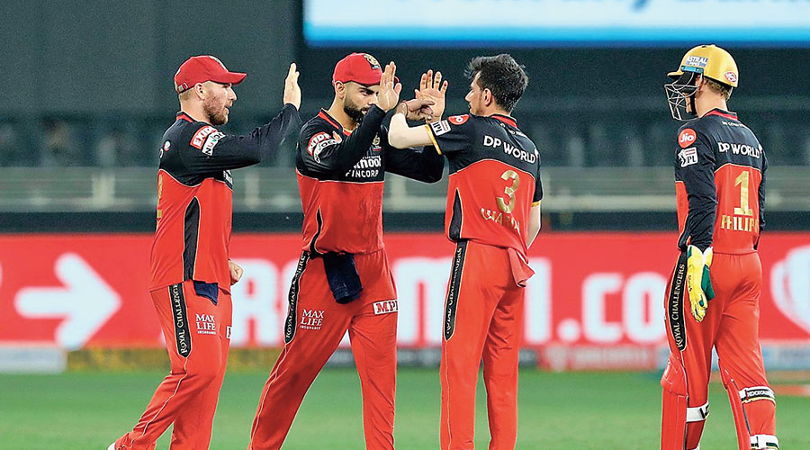 MoM Yuzvendra Chahal celebrates the wicket of Manish Pandey with his Royal Challengers Bangalore captain Virat Kohli during the match against Sunrisers Hyderabad in Dubai on Monday.