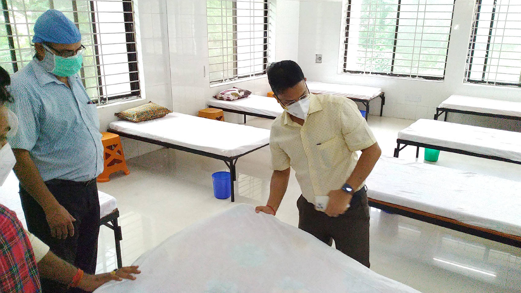 Dhanbad Deputy Commissioner Uma Shankar Singh checking the beds at the Covid health centre.
