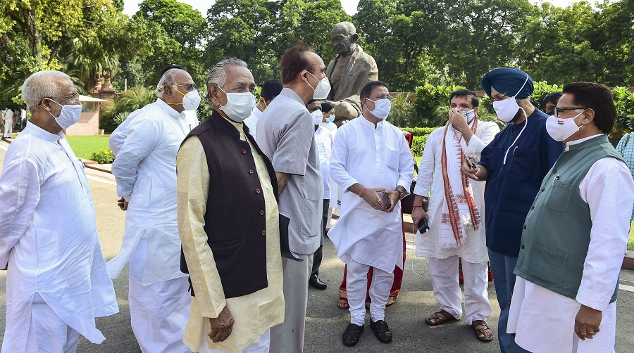 Congress MP Ghulam Nabi Azad and other opposition MPs stage a walkout from the Rajya Sabha demanding suspension of 8 lawmakers be revoked, at Parliament House in New Delhi on Tuesday.