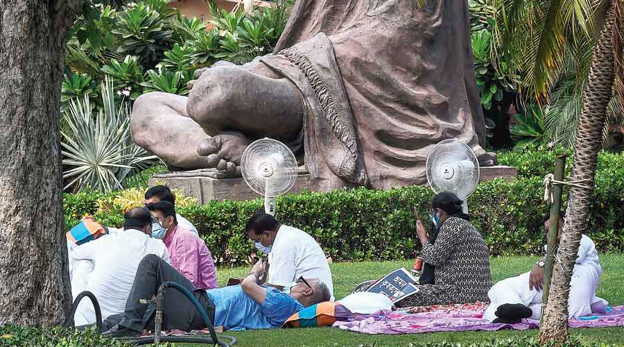 Suspended Rajya Sabha MPs staging a dharna near the Gandhi statue on the premises of Parliament House on Monday.