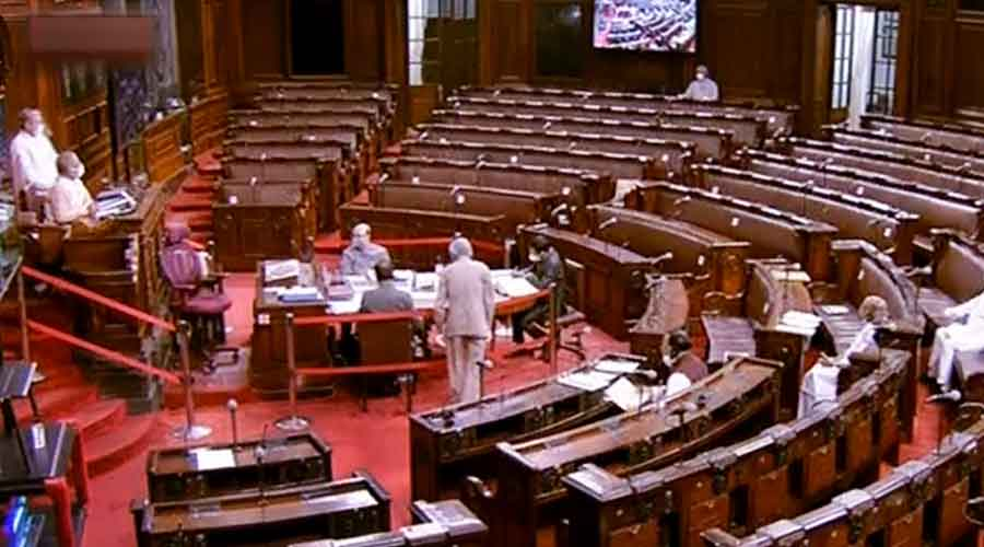 Parliamentarians in the Rajya Sabha after opposition MPs staged a walkout demanding suspension of eight lawmakers be revoked at Parliament on Tuesday