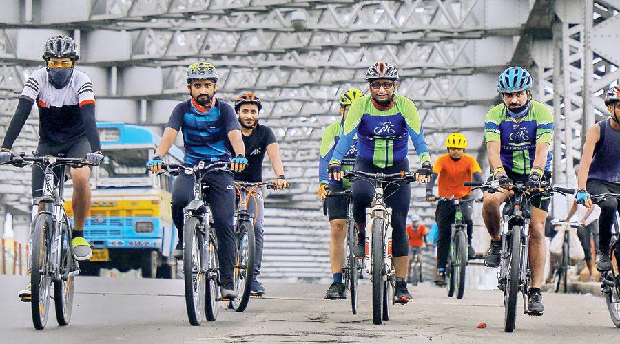 Cyclists on Howrah Bridge on Tuesday, World Car-free Day.