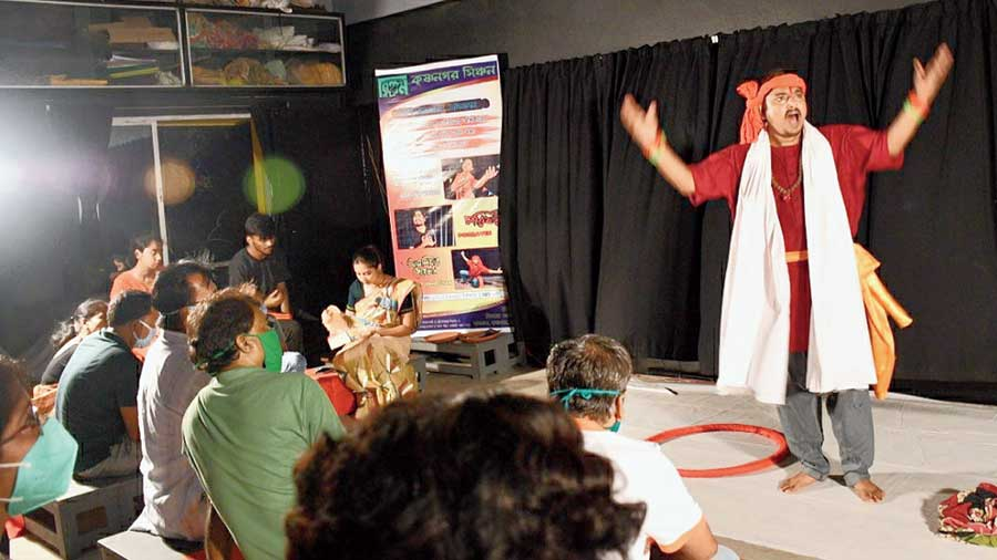 A member of Sinchan theatre group performs in front of selected audience in Krishnagar on Monday