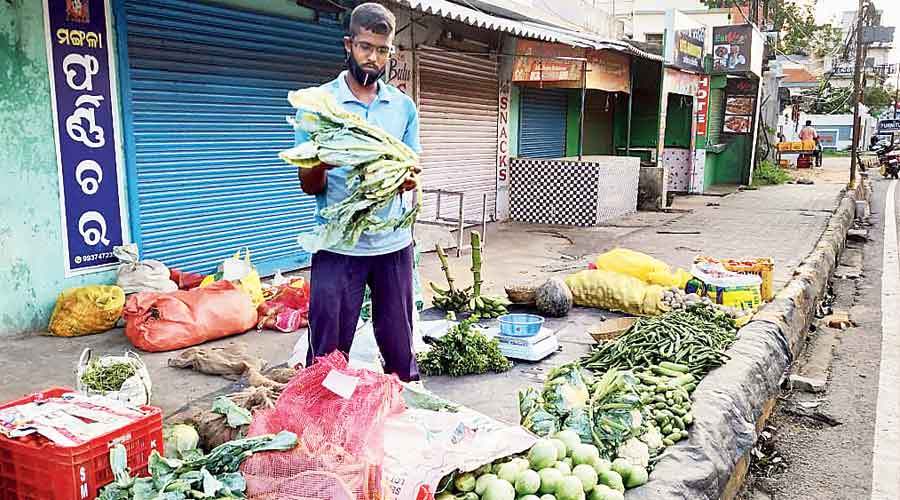 Nilachala Parida sells vegetables on the road side