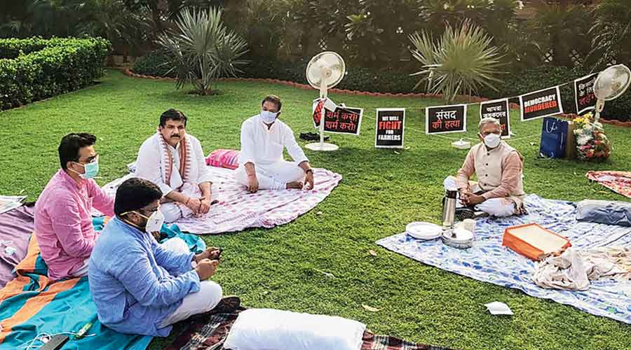 Deputy Chairman of the Rajya Sabha Harivansh Narayan Singh offers tea to suspended MPs on the premises of Parliament on Tuesday. The MPs protest over their suspension from the remaining monsoon session over the ruckus created in the Rajya Sabha