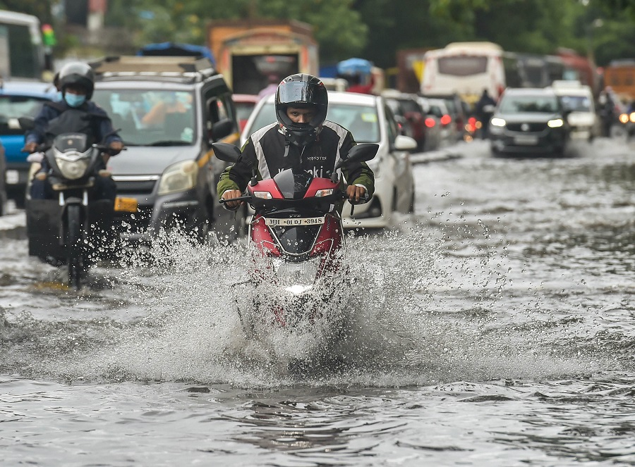 Vehicles move on a waterlogged street at Wadala in Mumbai on Wednesday.