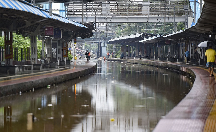 Waterlogged railway tracks at Chunabhatti railway station in Mumbai on Wednesday.