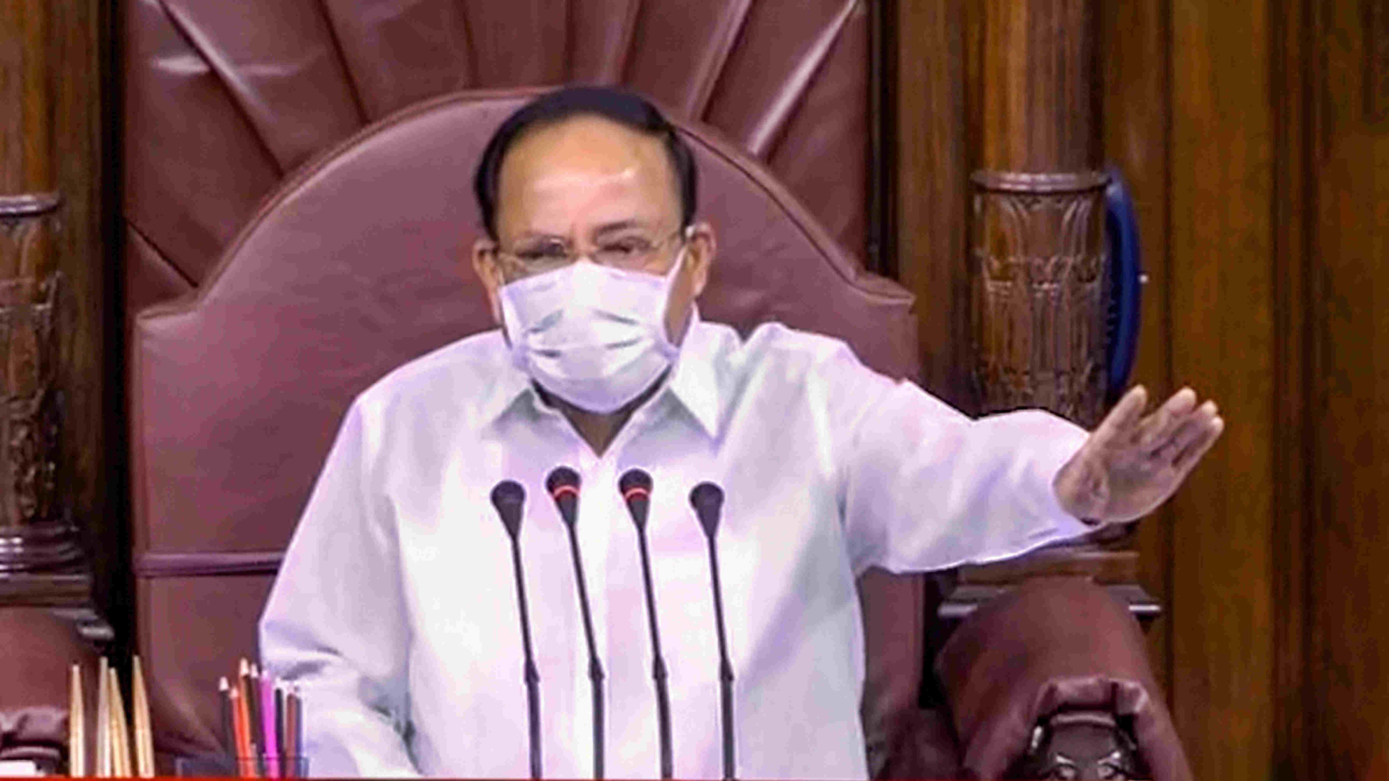 Rajya Sabha Chairman Venkaiah Naidu conducts proceedings in the upper house during the ongoing Monsoon Session of Parliament, at Parliament House in New Delhi, Tuesday , Sept. 22, 2020.