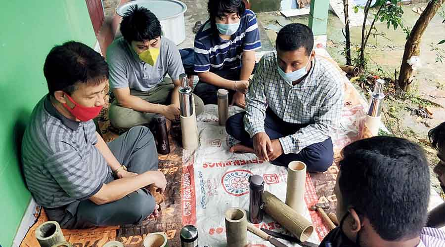 A training session for making bamboo bottles at the Forest Research Centre for Livelihood Extension  in Agartala.