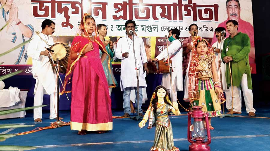 Performers at the Badhu song competition at Ruppur in Birbhum.